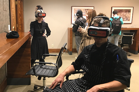 Two people with virtual reality sets on
